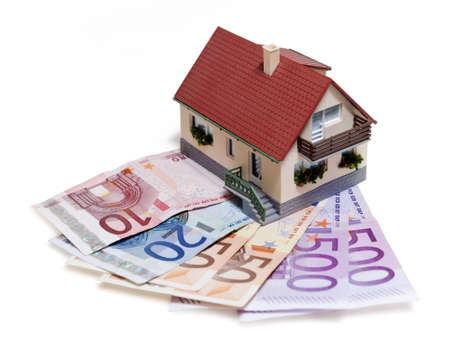 mortgaging: House with Euro banknotes over white background