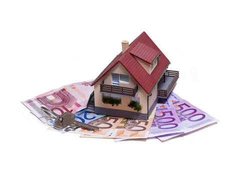 owe: House with Euro banknotes and house key over white background Stock Photo