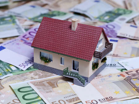 House over Euro banknotes background Stock Photo - 18016469