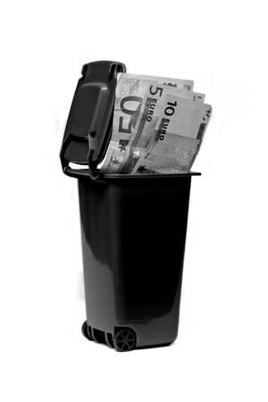 waste products: Money euro in recycle bin in black and white