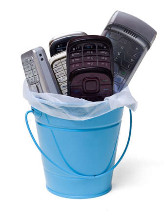 reprocess: garbage can filled with old  cell phones , isolated on white