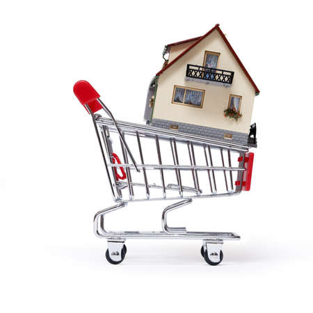 Model of the house in shopping cart on white background Stock Photo - 18016083