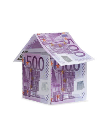 domiciles: house made of 500 euro money bills isolated on white background