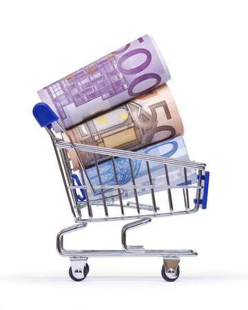 banconote euro: carrello della spesa con banconote in euro su sfondo bianco