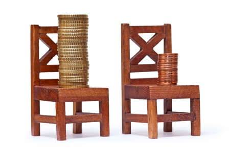 subsistence: Stack of euro coins on wooden chairs on white