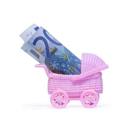 care allowance: Money euro in stroller on white  Stock Photo