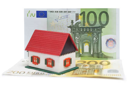 House with Euro banknotes over white background photo