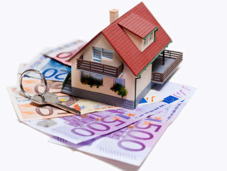 House with Euro banknotes and house key over white background Stock Photo