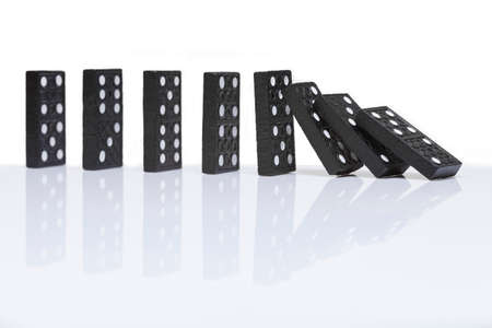chain reaction: row of dominoes with one falling over