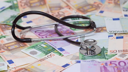 private insurance: euro banknotes and stethoscope
