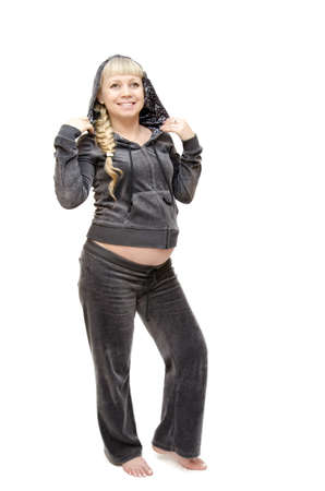 tracksuit: Portrait of pregnant woman in a tracksuit on white background