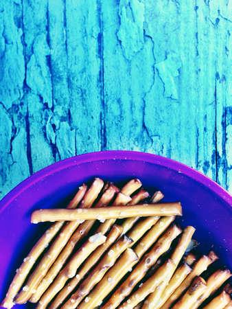 Pretzel sticks in cup  Фото со стока