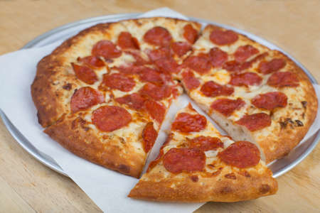 Pepperoni pizza on a plate Stock Photo