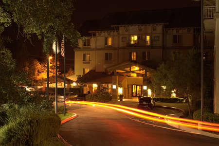 Four story hotel at night in Folsom CA