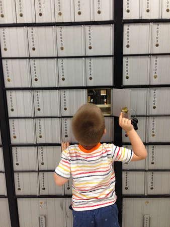 Small boy checking mailbox