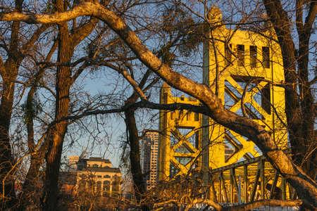 Sacramento Tower bridge through winter trees Stock Photo