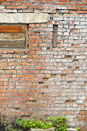 boarded up: The old shabby brick wall with boarded up window for background and textures