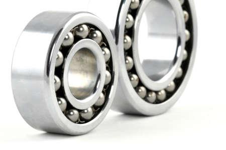 Macro shot of two silver ball bearings photo