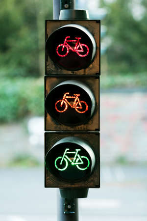 red, orange and green colour at raffic sign - bicycle road photo