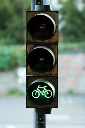 green light on the semaphore - bicycle road photo