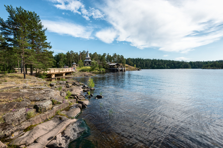 The rocky coast of the large island of Valaam. Valaam is a cozy and quiet piece of land, the rocky shores of which rise above the lush waters of lake Ladoga