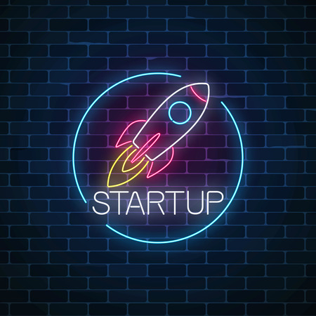 Glowing neon sign of business project startup in circle frame on dark brick wall background. Business fast start symbol as a flying rocket in neon style. Vector illustration.