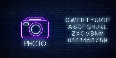 Neon sign of photo camera symbol with text and alphabet on dark brick wall background. Photography camera sign. Photo logo. Vector illustration. Illustration