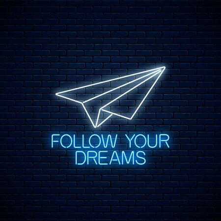 Follow your dreams - glowing neon inscription phrase with paper airplane on dark brick wall background. Motivation quote in neon style. Vector illustration.