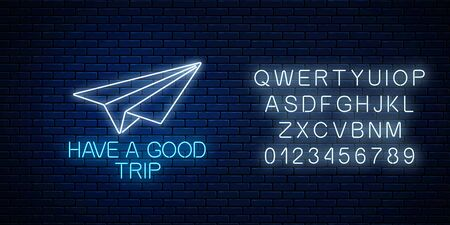 Have a good trip glowing neon banner with paper airplane sign and alphabet on dark brick wall background. Bon voyage wish banner. Vector illustration.