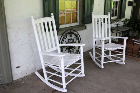 Two white rocking chairs.