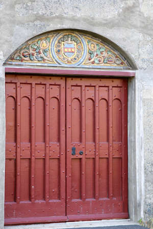The red door at the historic building. Editorial