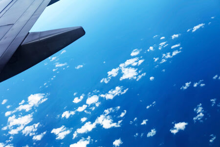 meta: The plane was flying in the sky. Stock Photo