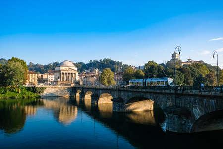 Turin cityscape, tram crossing a bridge