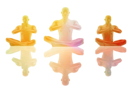 seated: Three persons seated in yoga position Stock Photo