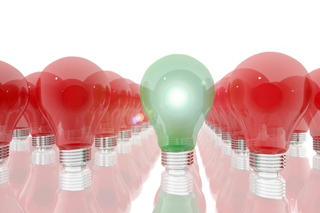 Green lightbulb surrounded by red light bulbs Stock Photo