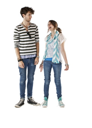 Teen girl smiles and looks up at skeptical teen boy  Vertical, isolated on white, copy space