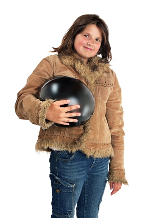 Smiling preteen girl in leather fringe jacket holds motorbike helmet  Friendly attitude, relaxed standing pose, isolated with white background, vertical layout and copy space Stock Photo - 14570150