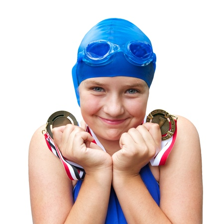 Cute pre teen girl in cobalt blue swimwear smiles proudly and holds two swimming medals close to her face  Square format, isolated on white background, copy space  Stock Photo - 14570130