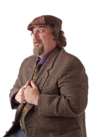 double chin: Heavy middle-aged man with goatee, cap and tweed jacket has hands gripping lapels. Horizontal, isolated on white, copy space. Stock Photo