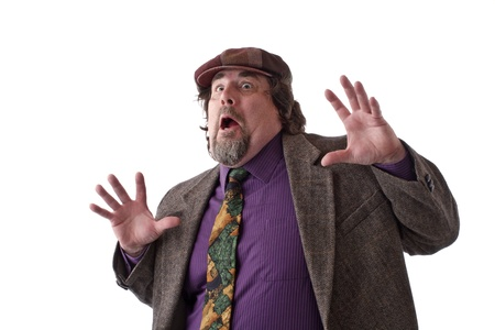 double chin: Heavy middle-aged man with goatee, cap and tweed jacket has hands flung up and mouth wide open. Horizontal, isolated on white, copy space.