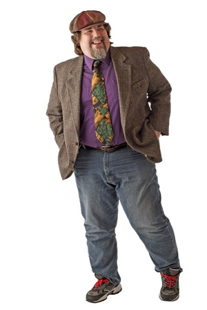 Large man in tweed cap and jacket laughs and stands with both hands in back pockets. Isolated on white background, vertical, copy space. photo