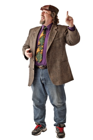 Large man in tweed cap and jacket smiles,  stands with one arm raised and index finger up. Isolated on white background, vertical, copy space. photo