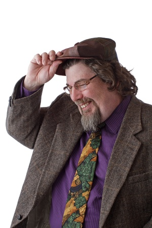double chin: Heavy set middle-aged man with goatee, glasses and tweed jacket tips cap and laughs. Vertical, isolated on white, copy space.