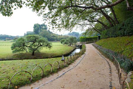 recedes: Traditional earthen path recedes in Korakuen Garden, Japan