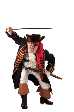 Classic 18th century bearded pirate captain lunging forward with raised sword in challenging pose  Isolated on white background with plenty of room for copy