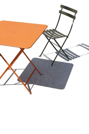 folding chair: Colorful metal patio table and slatted chair with shadows make abstract design