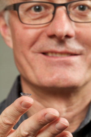 Smiling man with contact lens