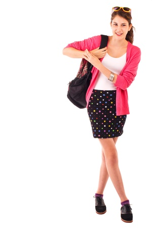 short back: Pretty smiling teenage girl in fashionable back to school clothes carries a backpack over her shoulder. Pink sweater, sunglasses on top of head, black short skirt. Vertical, isolated on white, copy space.