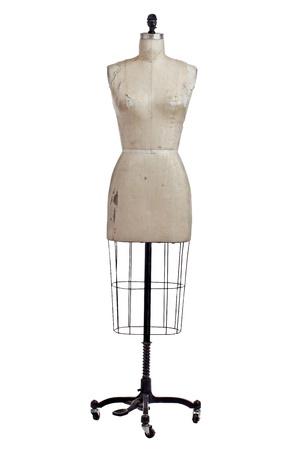 forma: Antik varrónők alkotnak bézs vászon huzat és fekete kovácsoltvas állni kerekek. Front view, függőleges, elszigetelt, fehér, másolás helyet. Stock fotó