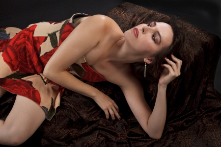 dark haired: Beautiful young dark haired woman in sexy strapless long dress Stock Photo